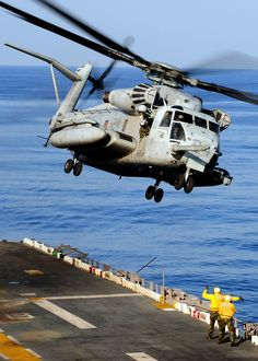 Helicopter Clears the Flight Deck by US Navy, via Flickr