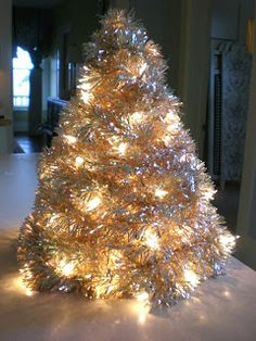 Marilyn makes Mention: Tinsel Tree Tutorial - vintage, made out of coat hangers - my grandma had one just like this!!!
