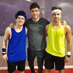 X Factor contestants RYan and Matt with Fitbit PT James #fitbitfactor