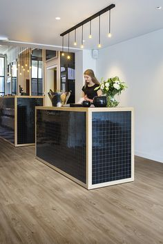Black & wood reception desk with ambient lighting - PURE Columbian Oak 636M luxury vinyl tiles by BerryAlloc // GLAM