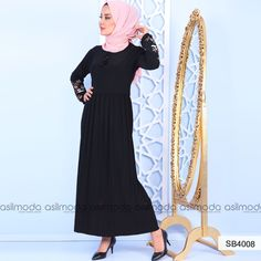 8782d02ffd682 ... Bayan Giyim,Tesettür Giyim,Elbise,Etek,Tunik,Kombin,Triko,Şal,Eşarp.  Siyah renkli elbisenin yakası püskül detaylıdır. Elbisenin kol uçları  lastikli olup ...