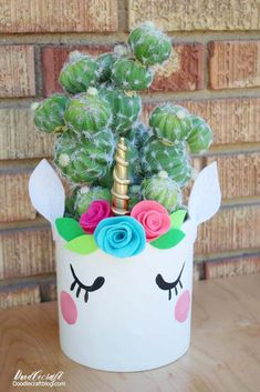 Make the most darling unicorn planters with some clay, paint, felt and a toothpick!