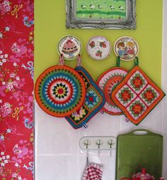 I'm a potholder fanatic and I love the bohemian color in this kitchen.