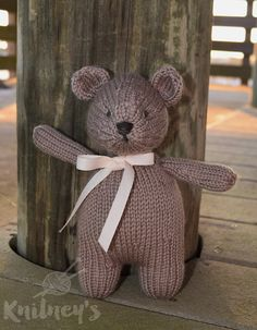 This adorable, handmade teddy bear is knitted with 100% Merino Wool. Standing at 8.5 inches (21.5 cm) tall, he is the perfect size to give to a small