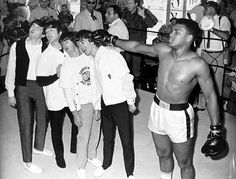 "♫ 1964. It's just days after The Beatles' historic, ratings record-shattering appearance on ""The Ed Sullivan Show"" and, to celebrate, they had a fun photo shoot with their favorite boxer Cassius Clay, who was coming up on his big title fight with the champion, Sonny Liston. There they are, posing and goofing around with the man who would become Muhammed Ali, 5 up-and-coming stars about to change the world. We're sure no one in the room really grasped just how huge of a moment this was. ♫"