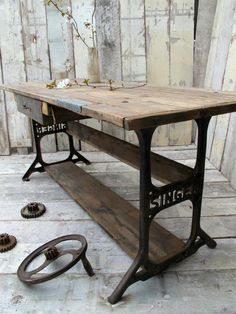 rustic table top with recyced legs from sewing machine.