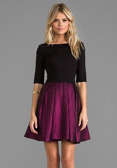 Sophisticated. Elegant. Gorgeous. This black and purple dress says it all.
