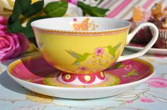 Hummingbirds yellow and pink teacup