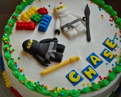 grrr i wish i like fondant! maybe just stick the real legos and guys on?