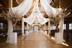 Rustic Themed wedding ceremony at the Bridgeport Art Center - Ceiling Swags, Branch Centerpieces, Chandelier