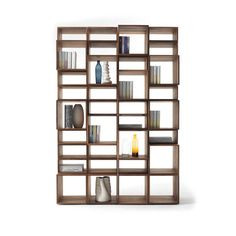 Made of solid walnut, this bookshelf gives you the Freedom to create your own unique design. Consisting of 34 independent modules, the variety of different shapes and sizes can be stacked and alternated to produce ever-changing compositions from the classic tall bookcase to a wide room divider.