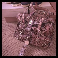 Jimmy choo limited edition pink Python handbag Limited edition Python handbag in like new condition. Retailed for $2000+. Comes with dust bag. The charm can be removed and used like a key chain. Jimmy Choo Bags Shoulder Bags