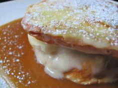 Surrey s Cafe - Bananas Foster French Toast from Food.com:   								YUMMMY! featured on Guy's diner's drive-ins and dives, a decadent and delicious french toast from Surrey's cafe in New Orleans..the right city for a bananas foster recipe! I edited the recipe to take into account 2blue's suggestions
