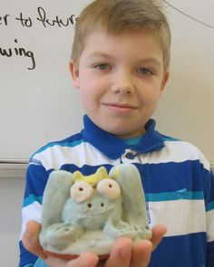 My students dip their clay animals in a white glaze. Then they paint colored glazes over the top. This style of glazing is called Majolica (may-o-lick-a). The reason we do this is that the kids use much less colored glaze and that saves money - and it teaches them about the history or using white glazes over red clays.  And most important of all, they don't have any misses - areas of their sculptures that are unglazed.