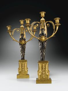 A PAIR OF PATINATED AND GILT-BRONZE CANDELABRA, EMPIRE