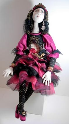 """OOAK cloth doll """"Paris"""" by Donna Perry. She has a recessed shrine in her torso."""