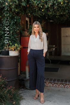 DETAILS: A pair of pinstriped cropped maternity pants featuring a wide leg style, side pockets, a cinched elastic waistband and double lining to prevent sheerness. Material has no stretch. This style was created to be worn before, during, and after pregnancy.