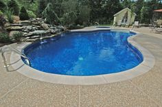 exposed aggregate pool decks   Lagoon with step, concrete edge cantilever, exposed aggregate deck ...