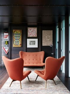 sofa and chairs Taller than my usual taste, but interesting. Love the color, and how it pops against the dark wall.