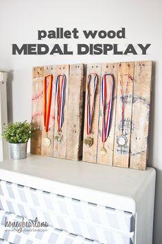 Repurposed wood pallet medal display