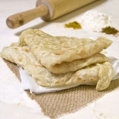 Light and flaky Guyanese roti. Perfect for scooping up warm West Indian curry. and flaky Guyanese roti. Perfect for scooping up warm West Indian curry. Roti Recipe Guyanese, Guyanese Recipes, Jamaican Recipes, Carribean Food, Caribbean Recipes, Naan, Guyana Food, Island Food, Gourmet