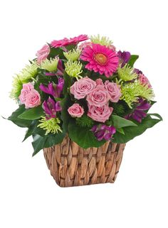 Pink spray roses and gerberas are an absolute delight! For lovers of basket arrangements, you can't go wrong with Jazz!