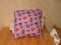 The Bratz's  throw pillow back is sold by MawmaRosesCrafts on Etsy