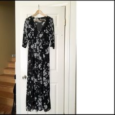 Maxi dress. Long sleeve Maxie dress with a white floral print. Has buttons in the front. Forever 21 Dresses Maxi