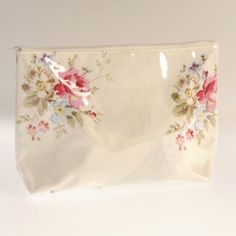 Miss Rose Sister Violet Spring Floral Washbag - This wonderful feminine cosmetic bag features a lovely spring posy floral chintz with a layer of clear plastic coating the outside. Made by Miss Rose Sister Violet, this bag is a nice choice for holding your cosmetics and it is small enough to easily fit in most purses.