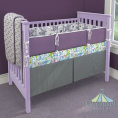 Crib bedding in Black Gingham, Purple and Navy Leopard Floral, Solid Aubergine Purple, Onyx Hugs and Kisses, Purple Drops, Orchid Painted Paisley. Created using the Nursery Designer® by Carousel Designs where you mix and match from hundreds of fabrics to create your own unique baby bedding. #carouseldesigns