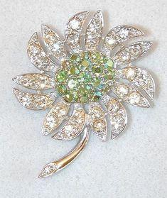 3078ad3bd4d Very pretty pin the just feels like summer! Shimmering pale green aurora  borealis rhinestones make