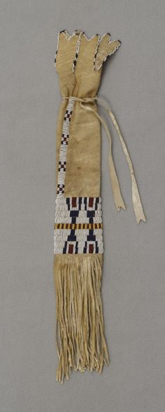 Tsistsistas (Cheyenne), Pipe Bag, about 1870s, Leather, glass beads, and sinew, Overall: 13 3/8 x 3 9/16 in. (34 x 9 cm). Hood Museum of Art, Dartmouth College: Gift of Mrs. William M. Leeds; 13.13.757.