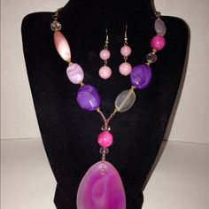 """Multi Colored Beaded Necklace Earring Set This purple , pink , orange , ivory multi colored beaded necklace fashion earrings set. Earrings are light pink in color. Necklace is approx: 12.0"""" (L)   Earrings approx: 1.0"""" (L) NWT Jewelry Necklaces"""