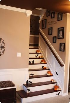 Sarah from Thrifty Decor Chick used removable silhouettes of mice and mouse holes from Martha Stewart on her newly finished stairwell. These are perfect for Halloween when paired with mini pumpkins and glowing votive candles.