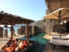 Six Senses Zighy Bay, Musandam Peninsula    One option for arrival at Six Senses Zighy Bay, in Oman, is via hang glider. You can take it from the top of a road that drops precipitously and spectacularly down to the beach. Then, you're whisked off to a quiet courtyard and served the most delicious dates as you check in