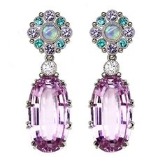 Platinum earrings featuring Kunzite (53.59 ctw.) accented with Opal (.60 ctw.), Paraiba Tourmaline (.60 ctw.), purple Spinel (1.00 ctw.) and Diamonds (.53 ctw.) from AGTA Member, Featherstone Design.