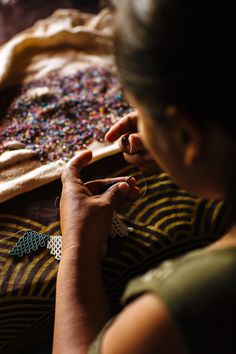 The intricate and colorful patterns with crystal beads are weaved by women from the EMBERA CHAMI community. The pieces have a design pattern, a symbolic reference, a ritual situation, which operate as a mental template that women attribute to collective memory and define as a legacy of the elderly. The community is located in the mountains of Antioquia. Beadwork, Crystal Beads, Color Patterns, Pattern Design, Template, Community, Colorful, Memories, Mountains
