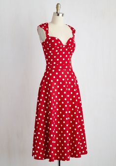 Simply arriving in this rich red dress shows fellow dance hall attendees you've got style. Now, scoot this retro midi by Bettie Page to the floor and verify what they suspect - that this white-dotted frock pairs flawlessly with some stellar moves!