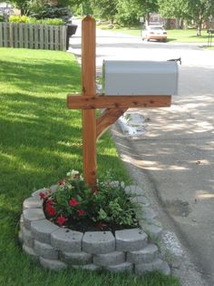How to make your street side mailbox look pretty. Add a planting bed using landscaping paver stones, add soil and lots of flowers!