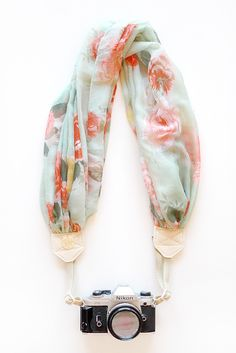 make a homemade neck strap out of a scarf or some fabric! genius! Totally thought of you @Roxana Greszta Lopez !!