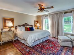 With a king-sized bed, walk-in closet, and large windows looking out over the secluded setting, the master bedroom is a bright and airy retreat. RELATED: This Family-Friendly California Farmhouse is Simply Lovely