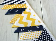 This adorable bunting is made with the cutest fabric! Yellow and Navy Blue Stripes, Chevron and Anchors make up this Fabric Bunting. ~Would add Yellow Nursery Decor, Nautical Nursery Decor, Nautical Party, Baby Decor, Nautical Banner, Fabric Bunting, Bunting Banner, Buntings, Anchor Nursery