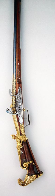 Gun: Country:France Collection:Arms and Armour Date:Circa 1605/1610 Technique:blued, chased, gilded and decorated with inlay.