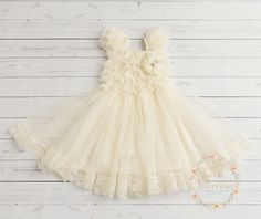 JOIN US in FB for FABULOUS WEEKLY GIVEAWAYS COUPONS AND SPECIAL OFFERS!  https://www.facebook.com/SweetValentinaBabyBoutique  This Ivory or white lace dress truly is rustic simplicity at its finest! Cascades of lace ruffle top and chiffon skirt with stunning lace trim (one piece). Perfect to wear as a flower girl dress in a rustic country wedding, birthdays, Christening, baptism, special occasions and more. * * * Headband is not included * * *  We recommend this headband to mat...