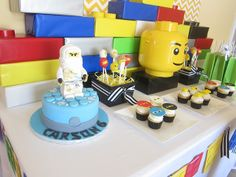 Lego Ninjago Birthday Party... The Lego boxes look super easy to make.