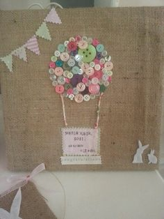 This pretty canvas is a perfect newborn gift. This is a sample which has been covered with hessian, decorated with buttons, cotton fabric and