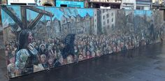 Chris Rutterford's Maggie Dickson mural on display in the Grassmarket in Edinburgh, Scotland.