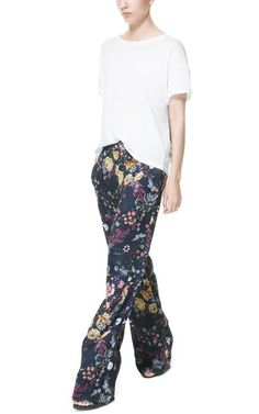Wide floral print trousers and white tee.