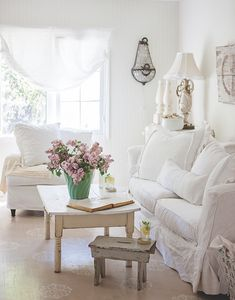 Some things never go out of style. This bright living room is both refreshing and cozy. #thecottagejournal #cottagestyle #cottage #cottageliving #interiordesign #interiors #livingroom #style #whitewashed #paintedfloors