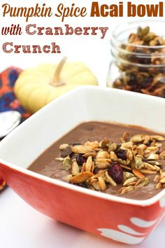 Pumpkin Spice Acai Bowls with Cranberry Crunch -- a fun holiday breakfast option or a delicious snack. fitnessista.com
